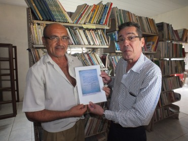 José da Silva and Anacleto Julião with letter to landowner Oscar Arruda Beltrão