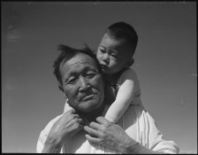 Manzanar Relocation Center, Manzanar, California. Grandfather and grandson of Japanese ancestry at this War Relocation Authority center. (Photo by Dorothea Lange).